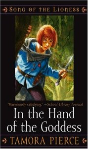 Cover depicting Alanna in a blue tunic carrying a knife