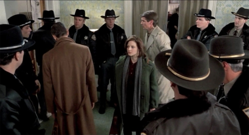 [Image: Clarice Starling on the case, surrounded by a room full of male law enforcement in sheriff's hats]