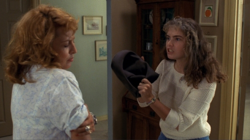 """Mom, I took Freddy's hat from my dream and also your foundation is orange."" [Image from A Nightmare on Elm Street: Nancy shows her mother Freddy's hat]"