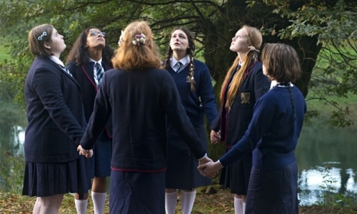 Via The Guardian. [Image: a group of British schoolgirls stand in a circle clasping hands]